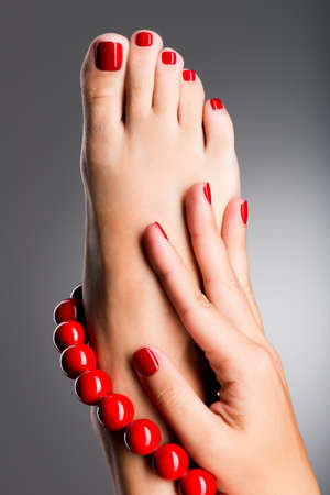 Closeup photo of a beautiful female feet at spa salon on pedicure procedure photo