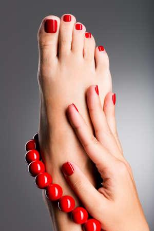 Closeup photo of a beautiful female feet at spa salon on pedicure procedure photo