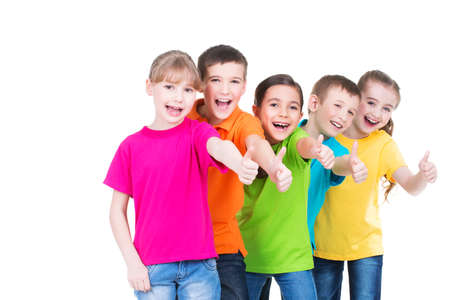 Group of happy kids with thumb up sign in colorful t-shirts standing together -  isolated on white.
