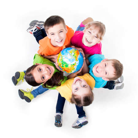 hand colored: Group of smiling kids sitting on the floor in a circle with a globe in his hands - isolated on white.