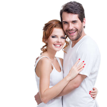 Portrait of beautiful attractive happy couple embracing over white background. photo