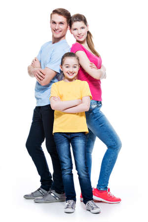 Full portrait of happy attractive family with daughter standing back to back at studio - isolated on white. photo