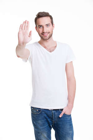 requiring: Young happy man requiring stop with his hand - isolated on white. Stock Photo