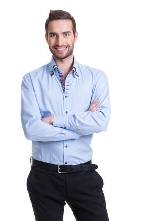 Portrait of smiling happy man in blue shirt and black pants with crossed arms - isolated on white.  photo