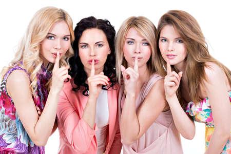 白い背景の上にスタジオでポーズをとってサイレント記号で若い美しい女性のグループ。 写真素材