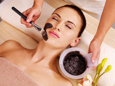 skin care face: Adult woman having beauty treatments  in the spa salon