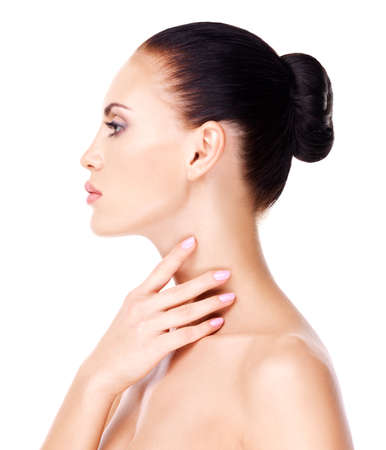 woman neck: Portrait of the beautiful woman who touches the neck by fingers - isolated on white
