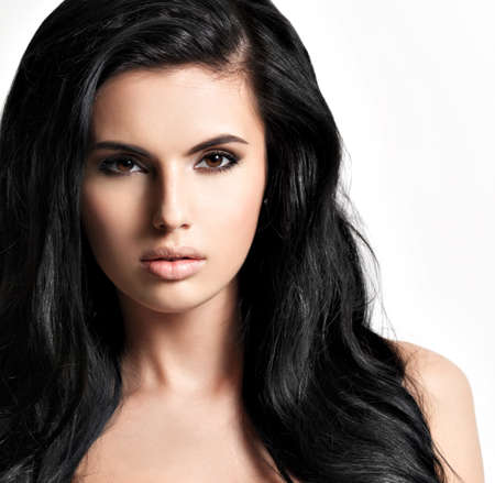 Portrait of the beautiful  young woman with black  hair - posing at studio
