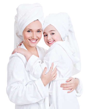 bath gown: Portrait of happy mother and young daughter in white dressing gown and towel- isolated. Happy family people concept. LANG_EVOIMAGES