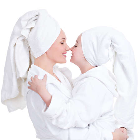 bath gown: Portrait of happy mother and young daughter in white dressing gown look at each other - isolated. Happy family people concept. LANG_EVOIMAGES