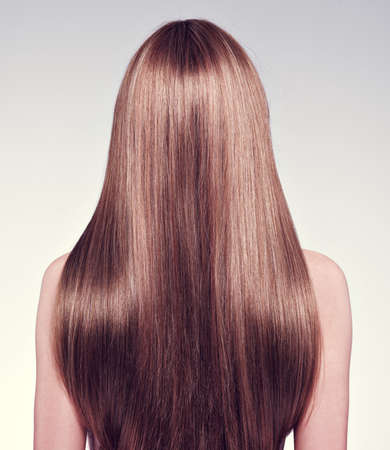 Rear view  of the woman with long  hair - studio