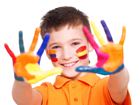 Happy smiling boy with a painted hands and face in orange t-shirt - on a white background.