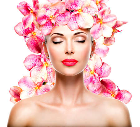 closed eye: Relaxed beautiful face of a young girl with clear skin and pink orchids. Beauty treatment concept