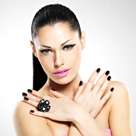 Face of the  beautiful sexy  woman with black nails and pink lips. Sexy girl with fashion makeup photo