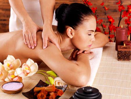 masseur: Masseur doing massage on woman body in the spa salon. Beauty treatment concept.