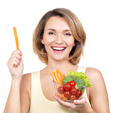 Beautiful young healthy woman with a plate of vegetables - isolated on white. Stock Photo
