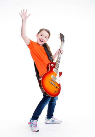 single songs: Cute girl plays on the electric guitar with bright emotions isolated on white background.