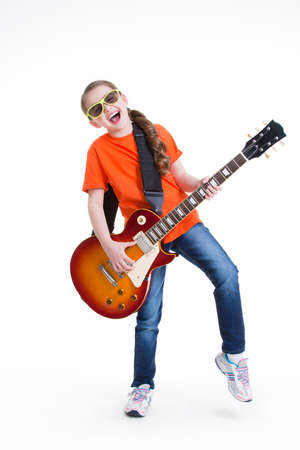 Cute girl plays on the electric guitar with glasses -  isolated on white background. photo
