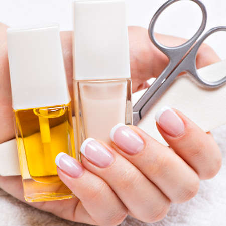 Woman in a nail salon receiving manicure by a beautician. Beauty treatment concept. photo