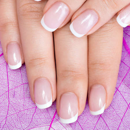 Beautiful woman's nails with beautiful french manicure Banque d'images