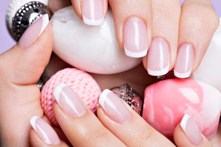 Beautiful womans nails with beautiful french white manicure