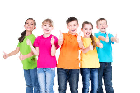 kid smiling: Group of happy kids with thumb up sign in colorful t-shirts standing together -  isolated on white.