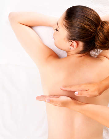 massage hands: Woman having massage of body in the spa salon. Beauty treatment concept.