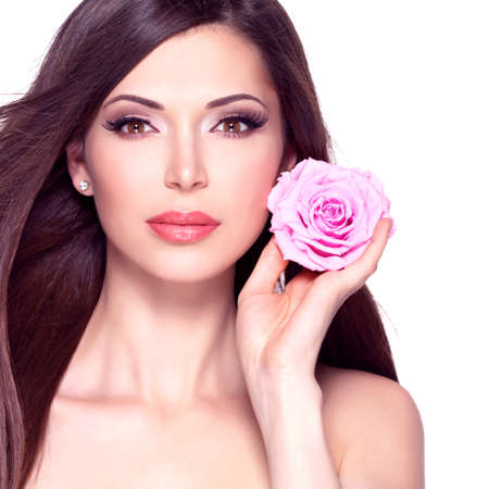 dishevel: Portrait of a beautiful white pretty woman with long straight hair and pink rose at face. Stock Photo