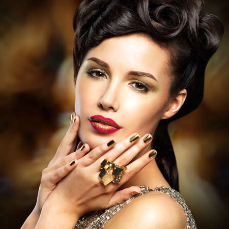 minx: Beautiful  woman with golded nails and bright red lips
