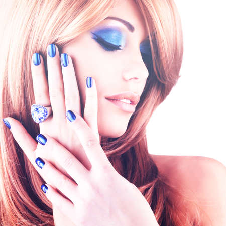 red nail colour: portrait of a beautiful woman with blue nails, blue makeup and red hairs  on white  background