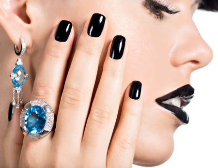 silver ring: Closeup face of young beautiful woman with black manicure and fashion bright makeup.