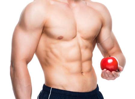 uomo rosso: Giovane uomo con il corpo perfetto che tiene mela rossa in mano - isolato su sfondo bianco. Archivio Fotografico