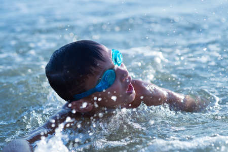 ten year old: Ten year old boy teenager swims in the sea
