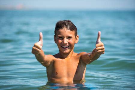 ��beautiful boy�: Young beautiful boy showing thumb up sign. Stock Photo