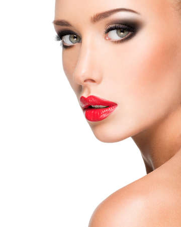 glamour makeup: Closeup portrait of a beautiful young fashion woman with glamour makeup posing at studio isolated on white.