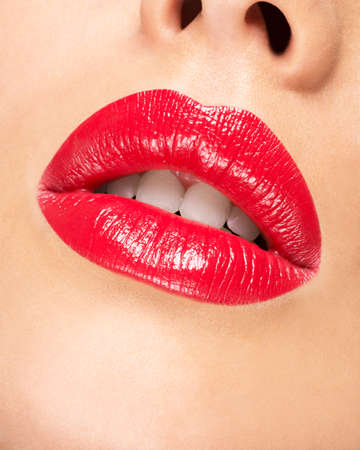 glamour makeup: Womans lips with red lipstick. Glamour fashion bright gloss make-up.