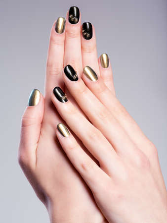 nails: Beautiful womans nails with beautiful creative manicure Stock Photo