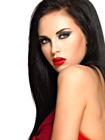 black hairs: Portrait of  the beautiful woman with  black straight hairs and red lips, evening makeup. Pretty model posing at studio