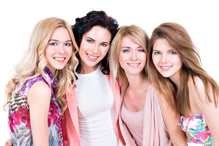 Group young beautiful smiling women in pink dresses - isolated on white. Stock Photo