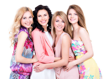 4: Group young beautiful smiling women in pink dresses - isolated on white. Stock Photo