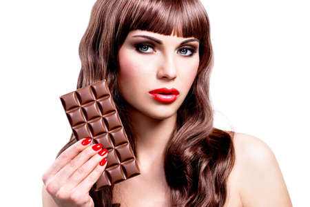 delicious food: Portrait of beautiful sexy woman with bar of chocolate. Closeup face with bright makeup, isolated on white.