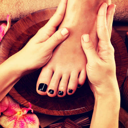 salon and spa: Massage of womans foot in spa salon - Beauty treatment concept