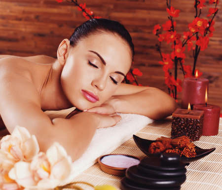 spa woman: Adult beautiful woman relaxing in spa salon. Beauty treatment therapy