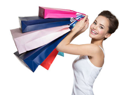 after shopping: Happy young smiling woman with shopping bags after shopping
