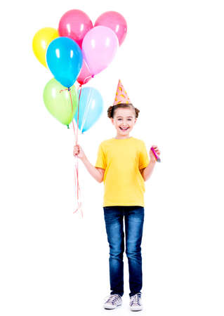 children birthday: Portrait of happy smiling girl in yellow t-shirt holding colorful balloons - isolated on a white. Stock Photo