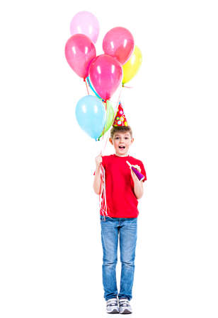 hubcap: Happy smiling boy in red t-shirt holding colorful balloons - isolated on a white.