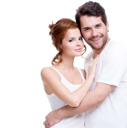 beautiful background: Portrait of beautiful smiling couple posing at studio over white background.