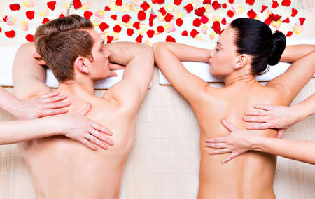 Couple getting deep back massage and relaxation at the luxury spa salon. Stock Photo