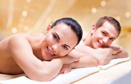 Couple lying on the massage desks on the spa salon. Beauty treatment concept. Stock Photo