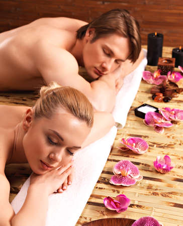 beauty and health: Couple lying on the massage desks on the spa salon. Beauty treatment concept. LANG_EVOIMAGES
